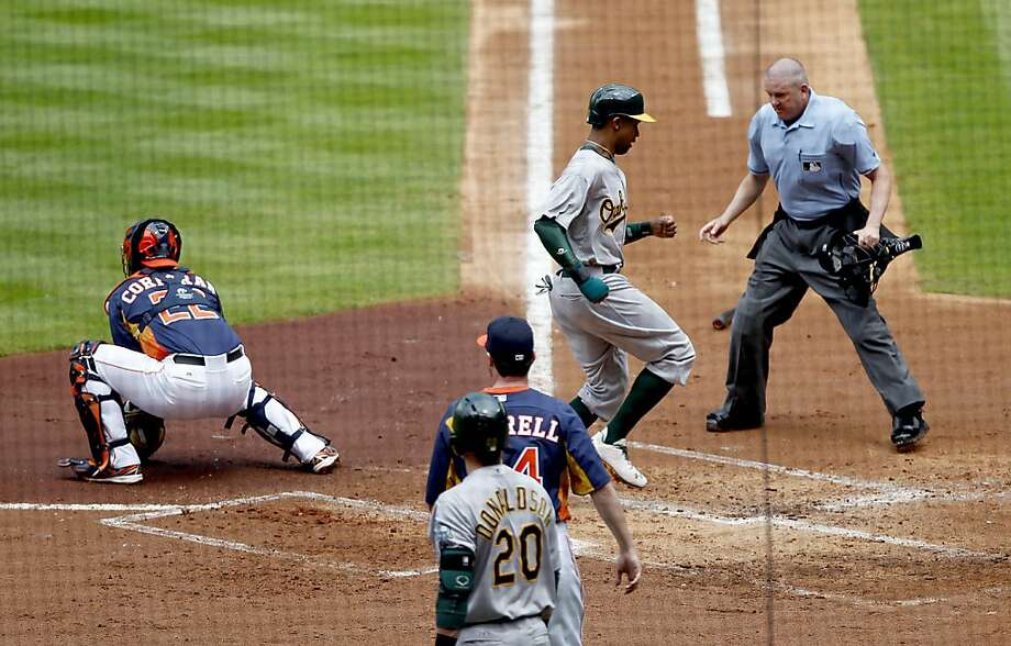 HOUSTON, TX - APRIL 07:  Chris Young #25 of the Oakland Athletics crosses the plate while Carlos Corporan #22 of the Houston Astros awaits the throw in the second inning at Minute Maid Park on April 7, 2013 in Houston, Texas.  (Photo by Thomas B. Shea/Getty Images) Photo: Thomas B. Shea, Getty Images