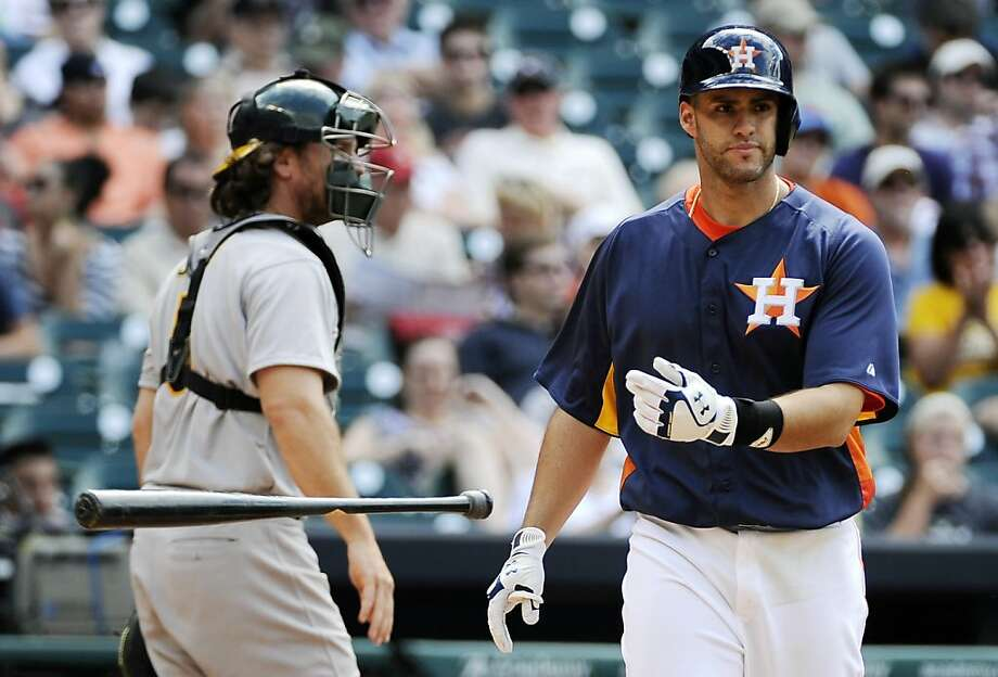 Houston Astros' J.D. Martinez, right, tosses his bat after striking out as Oakland Athletics catcher John Jaso heads to the dugout in the seventh inning of a baseball game on Sunday, April 7, 2013, in Houston. Oakland won 9-3 to sweep the Astros in the three game series. (AP Photo/Pat Sullivan) Photo: Pat Sullivan, Associated Press