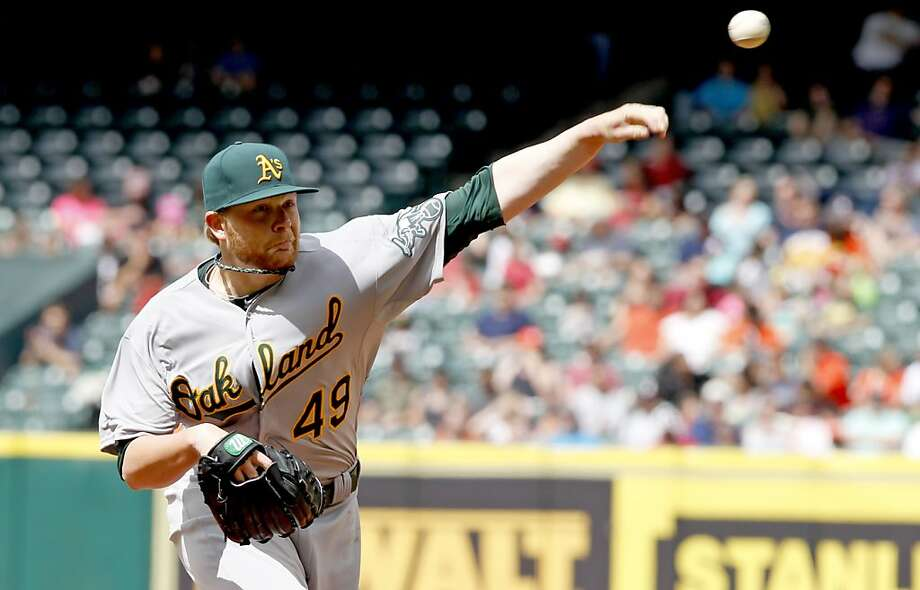HOUSTON, TX - APRIL 07: Brett Anderson #49 of the Oakland Athletics pitches in the sixth inning against the Houston Astros at Minute Maid Park on April 7, 2013 in Houston, Texas.  (Photo by Thomas B. Shea/Getty Images) Photo: Thomas B. Shea, Getty Images