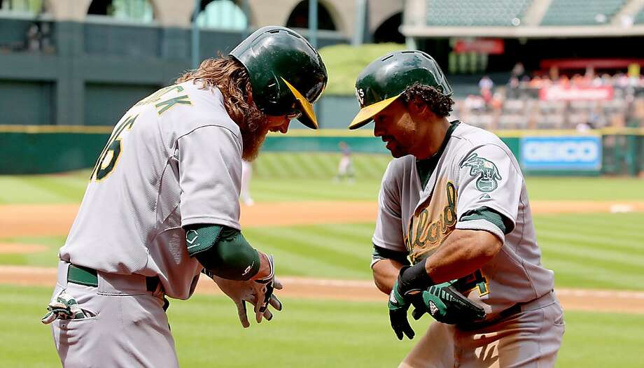HOUSTON, TX - APRIL 07: Coco Crisp #4 of the Oakland Athletics celebrates a home run with Josh Reddick #16 of the Oakland Athletics against the Houston Astros in the fourth inning at Minute Maid Park on April 7, 2013 in Houston, Texas.  (Photo by Thomas B. Shea/Getty Images) Photo: Thomas B. Shea, Getty Images