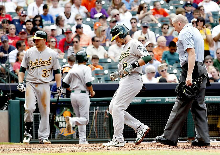 HOUSTON, TX - APRIL 07: Chris Young #25 of the Oakland Athletics touches home after hitting a two run home run against Lucas Harrell #64 of the Houston Astros in the third inning at Minute Maid Park on April 7, 2013 in Houston, Texas.  (Photo by Thomas B. Shea/Getty Images) Photo: Thomas B. Shea, Getty Images