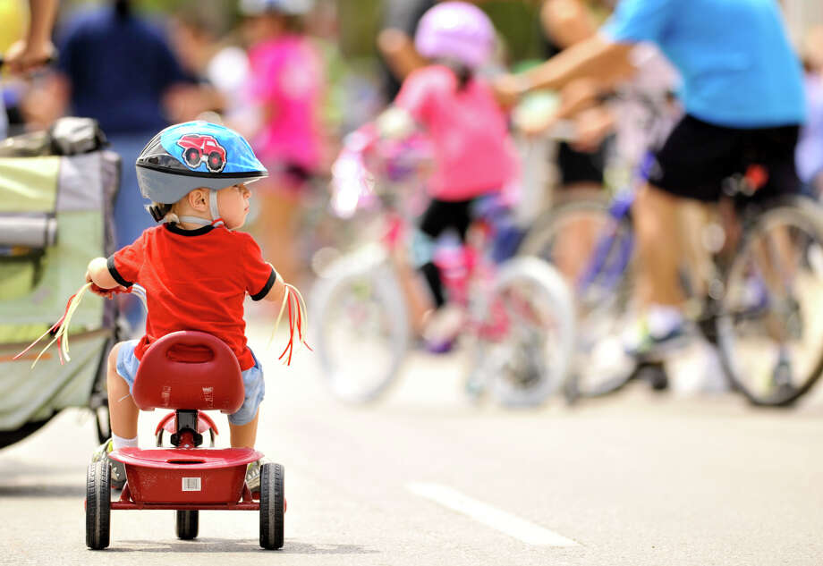 Wyatt Willcockson, 2, watches for traffic while riding in the 3rd annual Siclovia Sunday along Broadway St. The event was hosted by the City of San Antonio and the YMCA. Photo: Robin Jerstad, Express-News