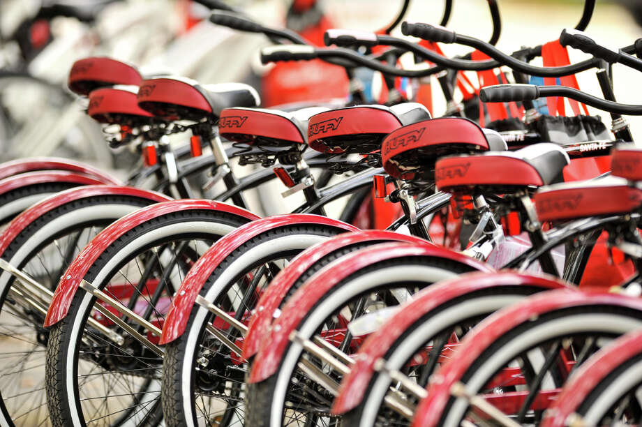 A row of shiny red bikes waits for riders along Broadway St. during the 3rd annual Siclovia event Sunday which was hosted by the city of San Antonio and the YMCA. Photo: Robin Jerstad, Express-News