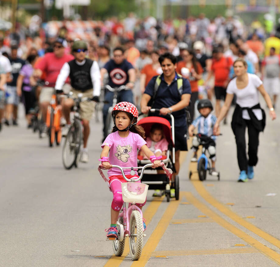 Marie Zeballos rides her bike along a closed Broadway St. during Sunday's 3rd annual Siclovia hosted by the city of San Antonio and the YMCA. Photo: Robin Jerstad, Express-News