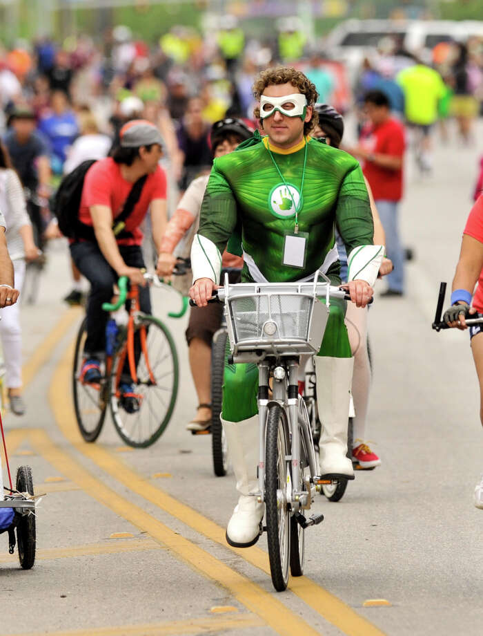 "Chris Matz, dressed as ""Capt. Human"", the mascot of SA Health Vending Co., rides along during the 3rd annual Siclovia on a closed Broadway St. Sunday. The event was hosted by the city of San Antonio and the YMCA. Photo: Robin Jerstad, Express-News"