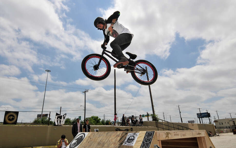 John Castillo gets some air-time on the bmx course set up at Sunday's Siclovia event along Broadway St. The event is hosted by the YMCA and the city. Photo: Robin Jerstad, Express-News