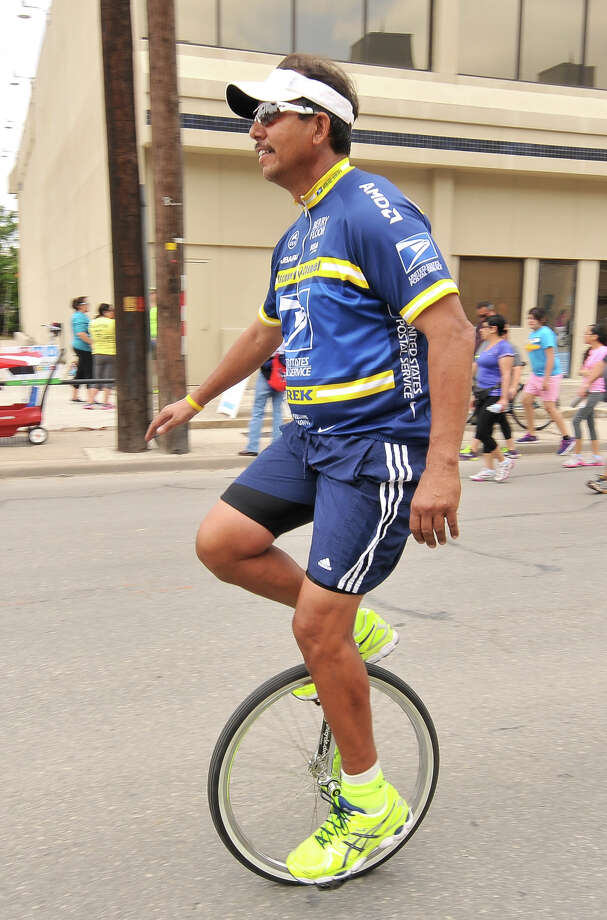 Daryl Padilla rides his unicycle along Broadway during Siclovia Sunday afternoon. The annual event drew thousands and was hosted by the city of San Antonio and the YMCA. Photo: Robin Jerstad, Express-News