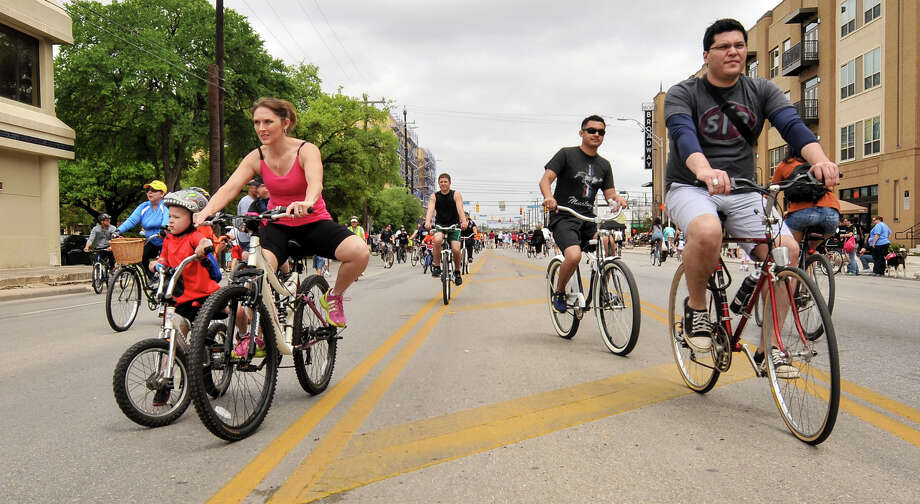Thousands of cyclists, runners, walkers, runners, and dogs participated in Sunday's Siclovia along Broadway St which was hosted by the city of San Antonio and the YMCA. Photo: Robin Jerstad, Express-News