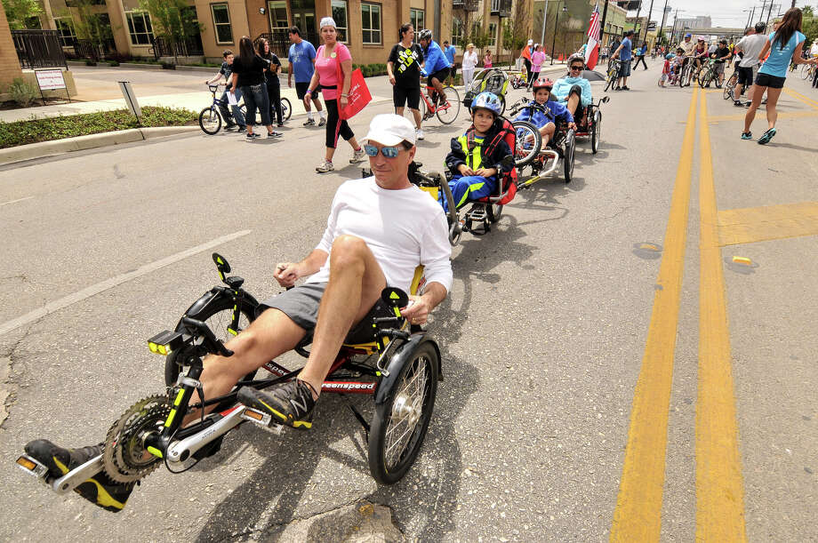 The Corso family, (front to back) Chris, Daniel, Dylan, and Cecilia ride along a closed Broadway St. during Sunday's 3rd annual Siclovia which was hosted by the city of San Antonio and the YMCA. Photo: Robin Jerstad, Express-News