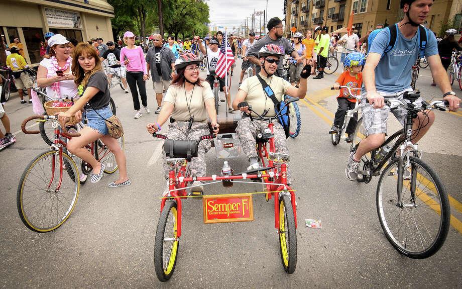 Annie and Jerry Moreno ride their quadcycle along Broadway St. during Sunday's 3rd annual Siclovia hosted by the city of San Antonio and the YMCA. Photo: Robin Jerstad, Express-News