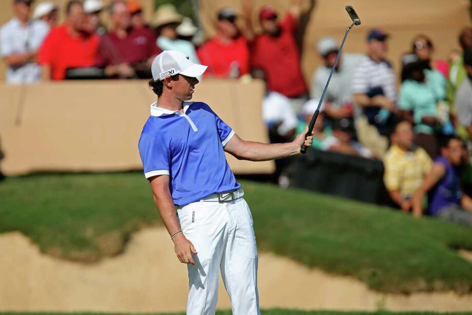 Rory McIlroy, of Holywood, Northern Ireland, reacts as he misses an eagle putt on the 18th green of the 2013 Valero Texas Open, Sunday, April 7, 2013. McIlroy went on to birdie the hole and ended in second place with a score of 12-under-par. Photo: Jerry Lara, Express-News / ©2013 San Antonio Express-News