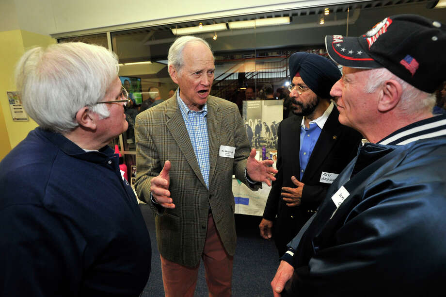 Bruce Gelb, center, talks with Fred Cofone, left, Ravi Dhingra, third from left, and Ralph Giamba, during the Clairol employee reunion at Chelsea Piers in Stamford on Sunday, April 7, 2013. The Clairol company used to be based in the building that Chelsea Piers now occupies. Gelb was president of Clairol from 1965-1976. He was also the U.S. ambassador to Belgium under President George H.W. Bush. Photo: Jason Rearick / The (Stamford) Advocate