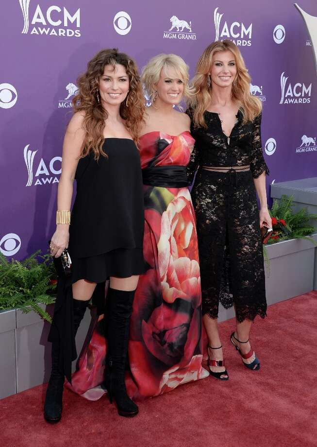 Country stars are taking over Las Vegas as the 48th Annual Academy of Country Music Awards took over the MGM Grand Garden Arena. (L-R) Singers Shania Twain, Carrie Underwood, and Faith Hill arrive at the 48th Annual Academy of Country Music Awards at the MGM Grand Garden Arena on April 7, 2013 in Las Vegas, Nevada. Photo: Jason Merritt, Getty Images / 2013 Getty Images