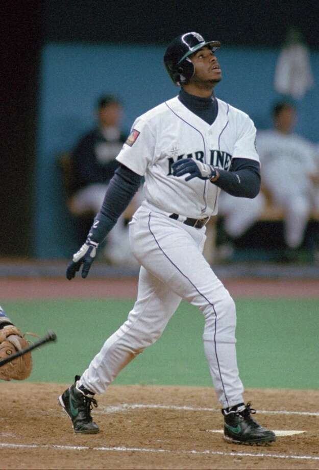 April 11, 1994 -- Mariners 9, Minnesota Twins 8 (10 innings) 57,806 attendance, sixth game of the season.  M's reliever Bobby Ayala blew a save (the first of many), but then ended up with the win. Third baseman Mike Blowers had a walk-off single in the bottom of the 10th, when he batted in Felix Fermin from second base.   Photo: Ken Griffey Jr. watches his seventh-inning home run off of Kansas City Royals pitcher Billy Brewer on May 18, 1994, in Seattle. Photo: Bill Chan, Associated Press