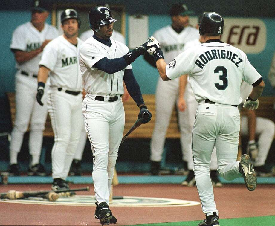 March 31, 1998 -- Cleveland Indians 10, Mariners 9 57,822 attendance, also the season opener.  Edgar Martinez homered in the first, and Russ David, Jay Buhner and Ken Griffey Jr. went deep during Seattle's six-run firth inning. But Seattle's bullpen squandered the come-from-behind win as Tony Fossas registered the loss and Mike Timlin got the blown save.   Photo: Alex Rodriguez, right, is congratulated by Ken Griffey Jr. after Rodriguez hit his 31st homer of the season against Kansas City pitcher Tim Belcher on July 19, 1998, in Seattle. Photo: Dan Levine, AFP / Getty Images