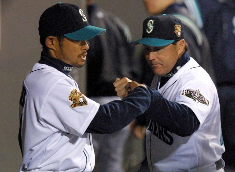 April 2, 2001 -- Mariners 5, Oakland Athletics 4 45,911 attendance, also the season opener.It was the first of 116 wins that season, and it happened after Ichiro Suzuki hit a bunt single to spark a game-tying rally in the seventh inning. M's DH Edgar Martinez was also intentionally walked twice.Photo: Ichiro Suzuki, left, is congratulated by coach John Moses after his bunt single seventh inning en route to their team's 5-4 victory over the Oakland A's on April 2, 2001, in Seattle. Suzuki had two hits and scored a run. Photo: Dan Levine, AFP / Getty Images
