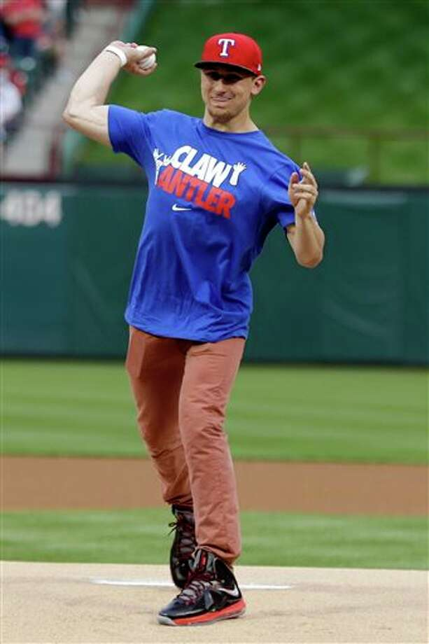 Johnny Manziel, Heisman Trophy winner and Texas A&M quarterback, throws out the ceremonial first pitch before a baseball game between the Los Angeles Angels and Texas Rangers, Sunday, April 7, 2013, in Arlington, Texas. Photo: LM Otero, AP / AP