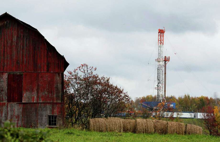 FILE - In this Oct. 14, 2011 file photo, a drilling rig is set up near a barn in Springville, Pa., to tap gas from the giant Marcellus Shale gas field. A new plan to strengthen standards for fracking is creating unusual divisions among environmentalists and supporters for the oil and gas industry. Some environmentalists say the new partnership between the gas companies and environmentalists is too soft, Others in the industry complain the program, announced March 20, 2013, goes too far. (AP Photo/Alex Brandon, File) Photo: Alex Brandon