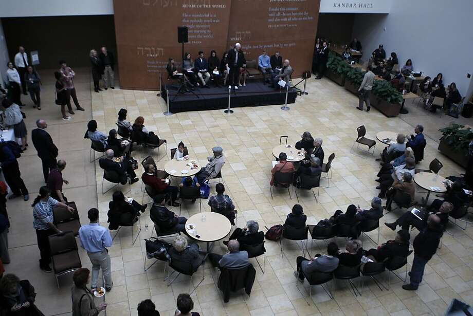 People gather for the reading of the names of Jews who were murdered during the Holocaust for Holocaust Remembrance Day at the Jewish Community Center on April 7th, 2013 in San Francisco, Calif. For Holocaust Remembrance Day, the Jewish Community Center in San Francisco is hosting several seminars, activities with kids doing art, and a reading of the names of Jews who were murdered during the Holocaust all between 1-6 pm. Photo: Jessica Olthof, The Chronicle