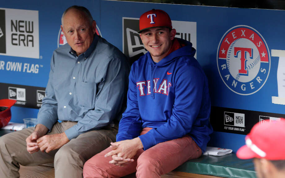 Heisman Trophy winner Texas A&M quarterback Johnny Manziel, right, visits with Texas Rangers president Nolan Ryan before the baseball game between the Los Angeles Angels and Texas Rangers Sunday, April 7, 2013, in Arlington, Texas. (AP Photo/LM Otero) Photo: LM Otero, Associated Press / AP