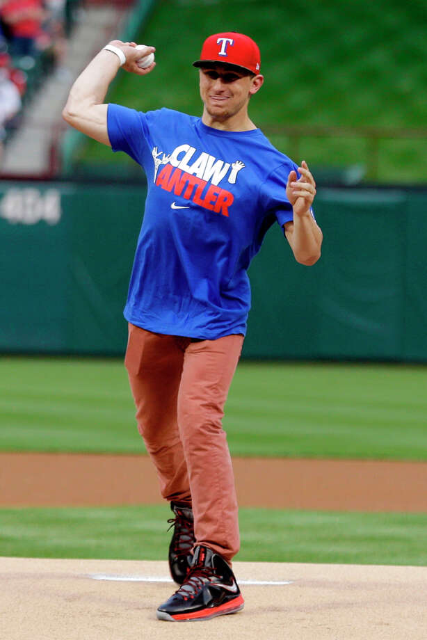 Johnny Manziel, Heisman Trophy winner and Texas A&M quarterback, throws out the ceremonial first pitch before a baseball game between the Los Angeles Angels and Texas Rangers, Sunday, April 7, 2013, in Arlington, Texas. (AP Photo/LM Otero) Photo: LM Otero, Associated Press / AP