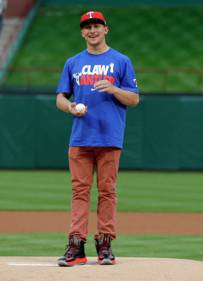 Heisman Trophy winner Texas A&M quarterback Johnny Manziel prepares to hrow out the first pitch before the baseball game between the Los Angeles Angels and Texas Rangers Sunday, April 7, 2013, in Arlington, Texas. (AP Photo/LM Otero) Photo: LM Otero, Associated Press / AP