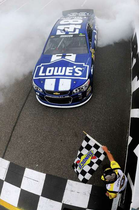 Jimmie Johnson led a career-best 346 laps and pulled away on a restart with eight laps left to win at Martinsville on Sunday. Photo: Jared C. Tilton / Associated Press