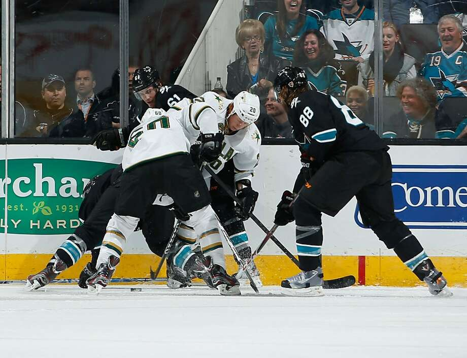 SAN JOSE, CA - APRIL 7: Justin Braun #61 and Brent Burns #88 of the San Jose Sharks fight for the puck against Cody Eakin #20 and Antoine Roussel #60 of the Dallas Stars during an NHL game on April 7, 2013 at HP Pavilion in San Jose, California. (Photo by Don Smith/NHLI via Getty Images) Photo: Don Smith, NHLI Via Getty Images