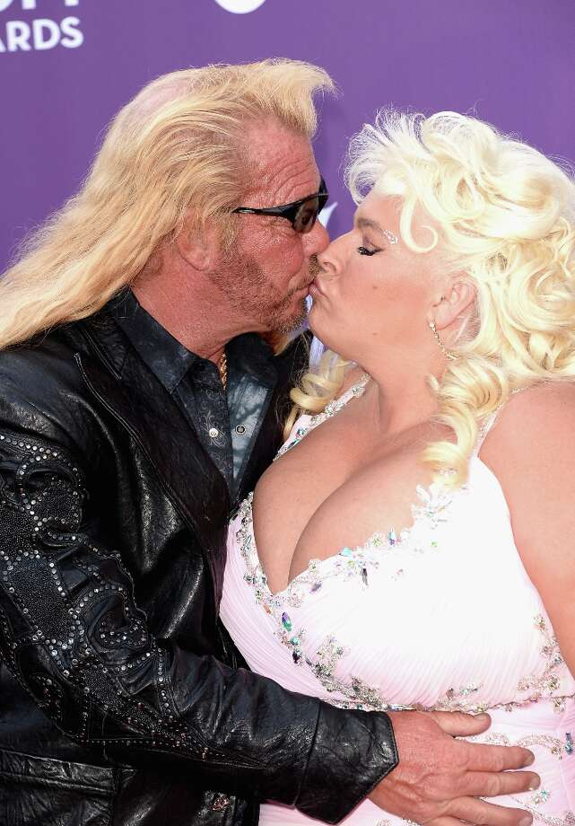LAS VEGAS, NV - APRIL 07:  TV personalities Dog the Bounty Hunter (L) and Beth Chapman arrive at the 48th Annual Academy of Country Music Awards at the MGM Grand Garden Arena on April 7, 2013 in Las Vegas, Nevada. Photo: Jason Merritt, Getty Images / 2013 Getty Images