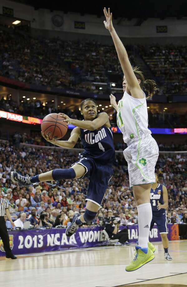 Connecticut guard Moriah Jefferson (4) goes up for a shot against Notre Dame forward Natalie Achonwa (11) in the first half of the women's NCAA Final Four college basketball tournament semifinal, Sunday, April 7, 2013, in New Orleans. (AP Photo/Gerald Herbert)