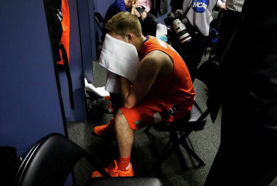 Syracuse's Griffin Hoffmann sits in the locker room after the second half of the NCAA Final Four tournament college basketball semifinal game against Michigan, Saturday, April 6, 2013, in Atlanta. Michigan won 61-56. (AP Photo/John Bazemore) Photo: John Bazemore
