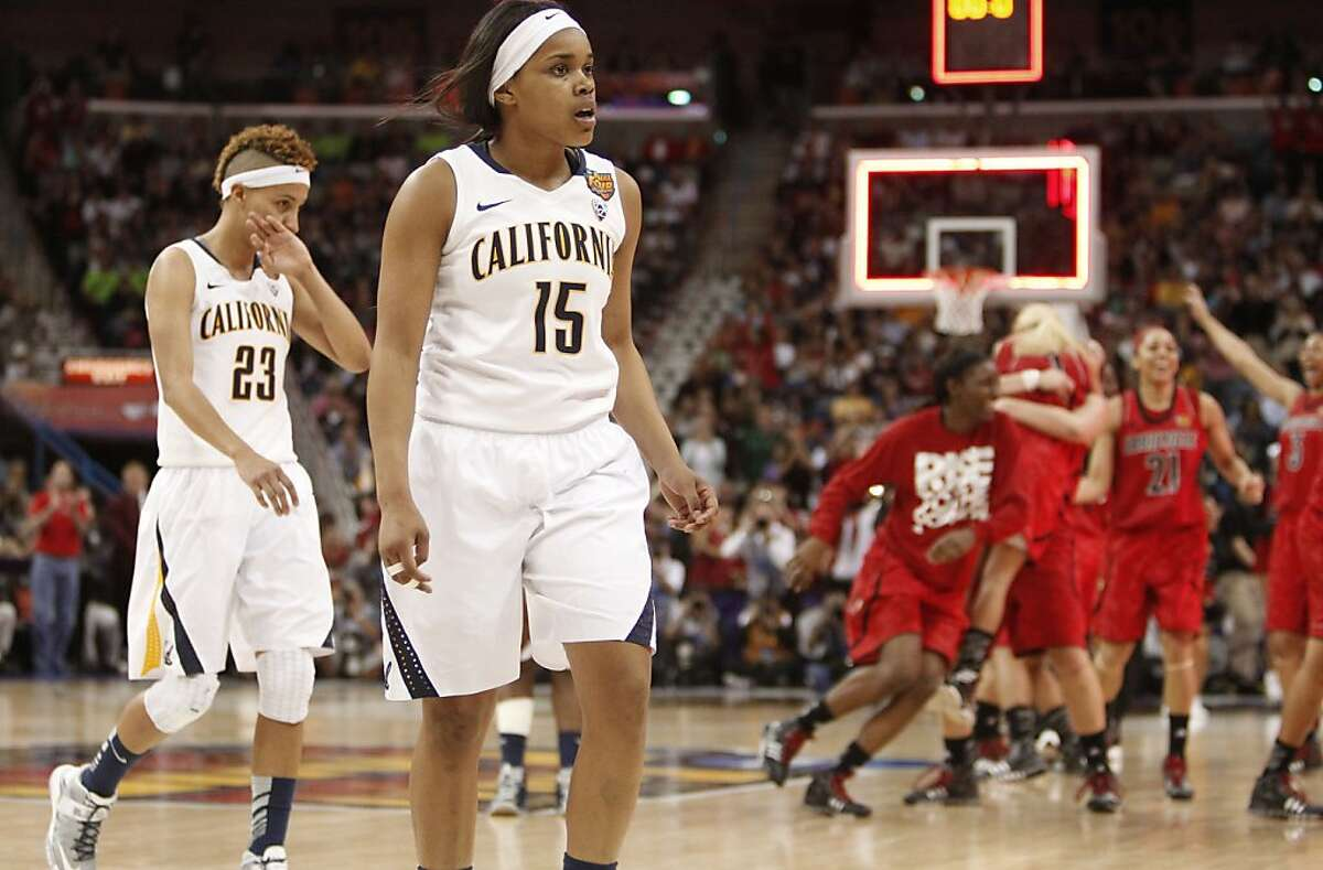 Louisville celebrates as time runs out on Cal players, Layshia Clarendon, (left) and Brittany Boyd as the Cal Berkeley women's basketball team falls to the Louisville Cardinals in the national semi-final game 64-57 in the NCAA Final Four Basketball Tournament in New Orleans, La. on Sunday April 7, 2013.