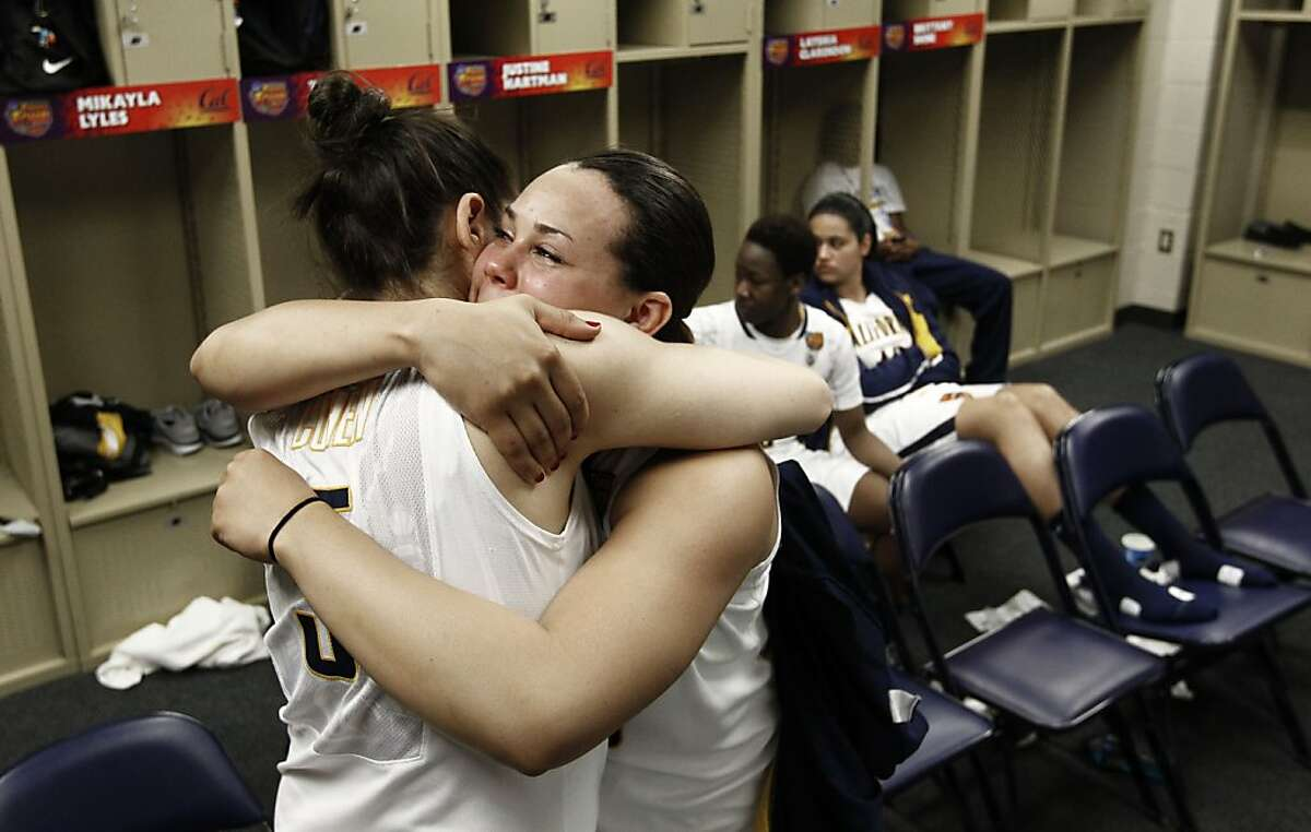 Cal players Avigiel Cohen, (left) and Mikayla Lyles hug after the game in the locker room as the Cal Berkeley women's basketball team lost to the Louisville Cardinals in the national semi-final game 64-57 in the NCAA Final Four Basketball Tournament in New Orleans, La. on Sunday April 7, 2013.