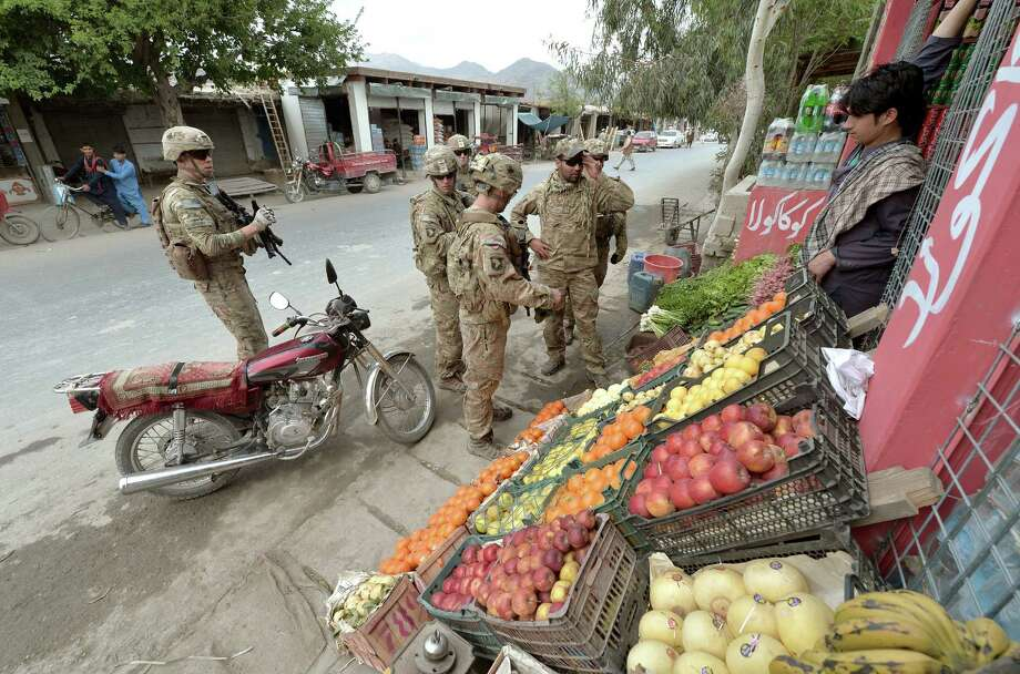 A day after three U.S. soldiers died in a suicide bombing in Afghanistan, troops patrol in the Kush Kunar district. Photo: Manjunath Kiran, AFP / Getty Images