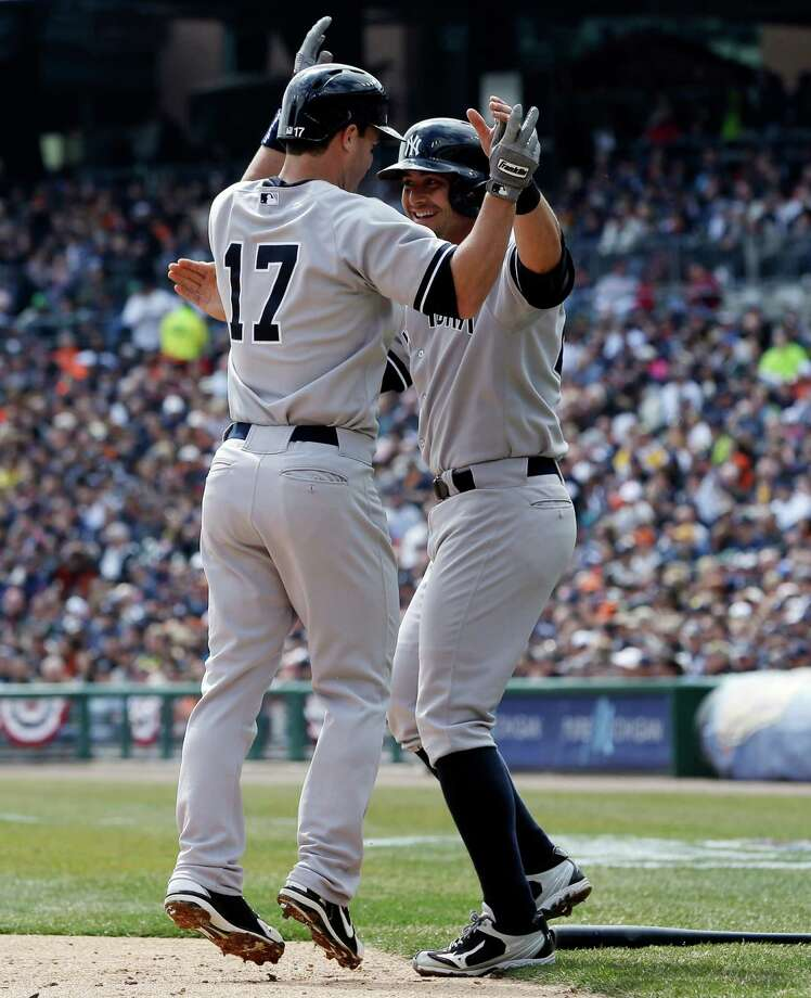 New York Yankees' Jayson Nix (17) is congratulated by teammate Francisco Cervelli after they both scored on Nix's two-run home run during the second inning of a baseball game against the Detroit Tigers in Detroit, Sunday, April 7, 2013. (AP Photo/Carlos Osorio) Photo: Carlos Osorio