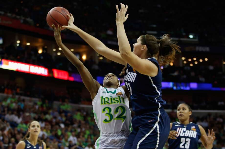 NEW ORLEANS, LA - APRIL 07:  Stefanie Dolson #31 of the Connecticut Huskies blocks a shot by Jewell Loyd #32 of the Notre Dame Fighting Irish during the National Semifinal game of the 2013 NCAA Division I Women's Basketball Championship at the New Orleans Arena on April 7, 2013 in New Orleans, Louisiana.  (Photo by Chris Graythen/Getty Images)