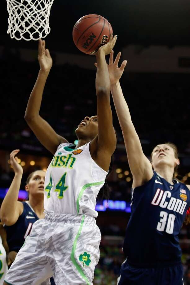 NEW ORLEANS, LA - APRIL 07:  Ariel Braker #44 of the Notre Dame Fighting Irish makes a shot over Breanna Stewart #30 of the Connecticut Huskiesduring the National Semifinal game of the 2013 NCAA Division I Women's Basketball Championship at the New Orleans Arena on April 7, 2013 in New Orleans, Louisiana.  (Photo by Chris Graythen/Getty Images)
