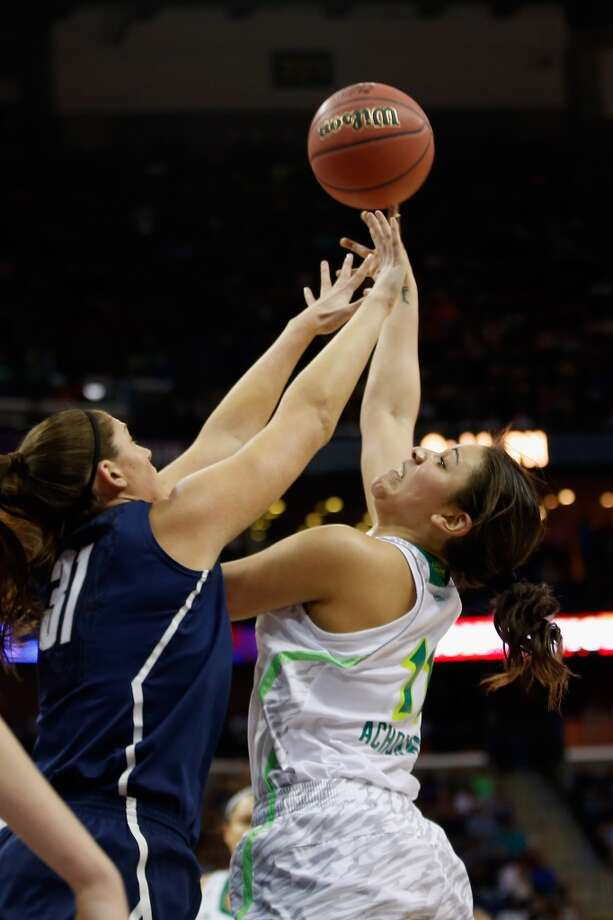 NEW ORLEANS, LA - APRIL 07:  Natalie Achonwa #11 of the Notre Dame Fighting Irish makes a shot over Stefanie Dolson #31 of the Connecticut Huskies during the National Semifinal game of the 2013 NCAA Division I Women's Basketball Championship at the New Orleans Arena on April 7, 2013 in New Orleans, Louisiana.  (Photo by Chris Graythen/Getty Images)