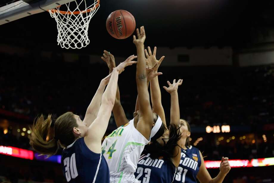 NEW ORLEANS, LA - APRIL 07:  Ariel Braker #44 of the Notre Dame Fighting Irish makes a shot over Breanna Stewart #30 of the Connecticut Huskies during the National Semifinal game of the 2013 NCAA Division I Women's Basketball Championship at the New Orleans Arena on April 7, 2013 in New Orleans, Louisiana.  (Photo by Chris Graythen/Getty Images)