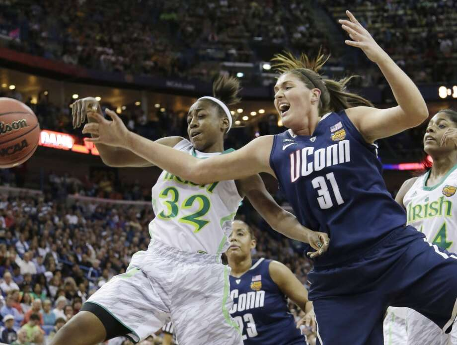 Connecticut center Stefanie Dolson (31) and Notre Dame guard Jewell Loyd (32) go after a loose ball in the first half of the women's NCAA Final Four college basketball tournament semifinal, Sunday, April 7, 2013, in New Orleans. (AP Photo/Gerald Herbert)