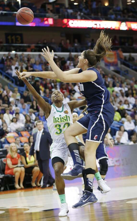 Connecticut center Stefanie Dolson (31) blocks a shot by Notre Dame guard Jewell Loyd (32) in the first half of the women's NCAA Final Four college basketball tournament semifinal, Sunday, April 7, 2013, in New Orleans. (AP Photo/Dave Martin)