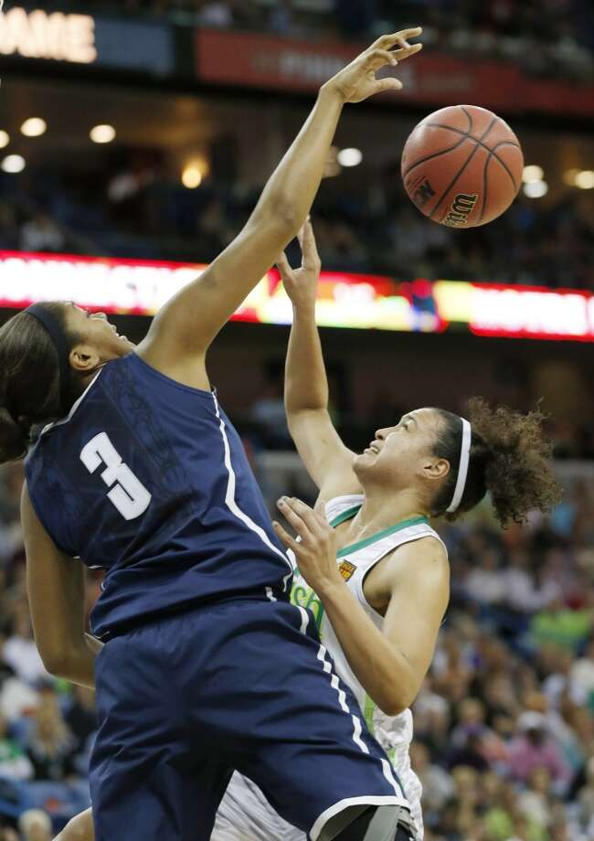 Connecticut forward Morgan Tuck (3) blocks a shot by Notre Dame guard Kayla McBride (21) in the first half of the women's NCAA Final Four college basketball tournament semifinal, Sunday, April 7, 2013, in New Orleans. (AP Photo/Dave Martin)