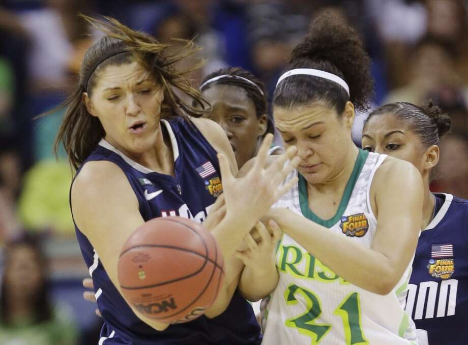 Connecticut center Stefanie Dolson (31) and Notre Dame guard Kayla McBride (21) battle for a rebound in the first half of the women's NCAA Final Four college basketball tournament semifinal, Sunday, April 7, 2013, in New Orleans. (AP Photo/Gerald Herbert)