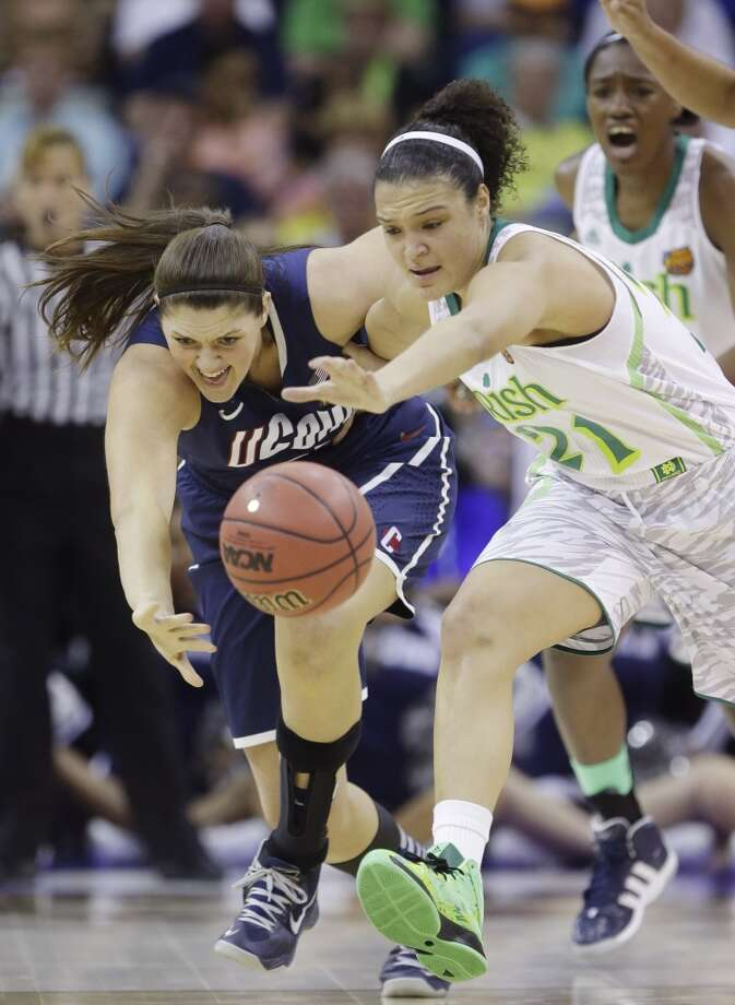 Connecticut center Stefanie Dolson (31) and Notre Dame guard Kayla McBride (21) chase a loose ball in the first half of the women's NCAA Final Four college basketball tournament semifinal, Sunday, April 7, 2013, in New Orleans. (AP Photo/Gerald Herbert)