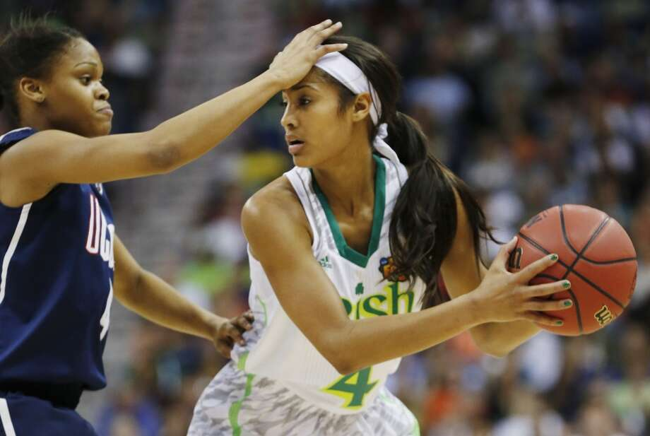 Connecticut guard Moriah Jefferson (4) defends against Notre Dame guard Skylar Diggins (4) in the first half of the women's NCAA Final Four college basketball tournament semifinal, Sunday, April 7, 2013, in New Orleans. (AP Photo/Dave Martin)