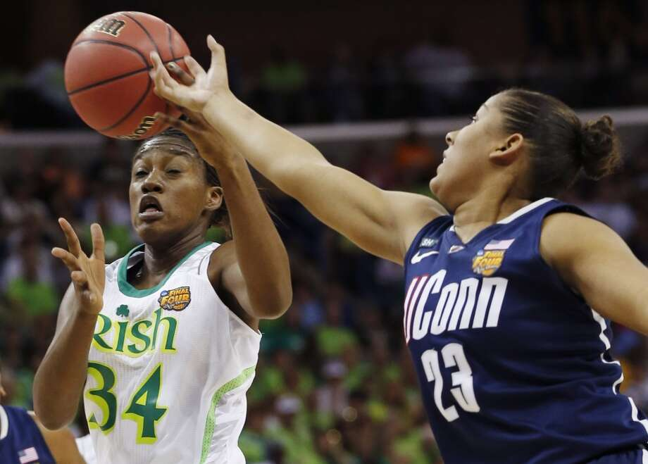 Notre Dame forward Markisha Wright (34) and Connecticut forward Kaleena Mosqueda-Lewis (23) reach for a rebound in the first half of the women's NCAA Final Four college basketball tournament semifinal, Sunday, April 7, 2013, in New Orleans. (AP Photo/Dave Martin)