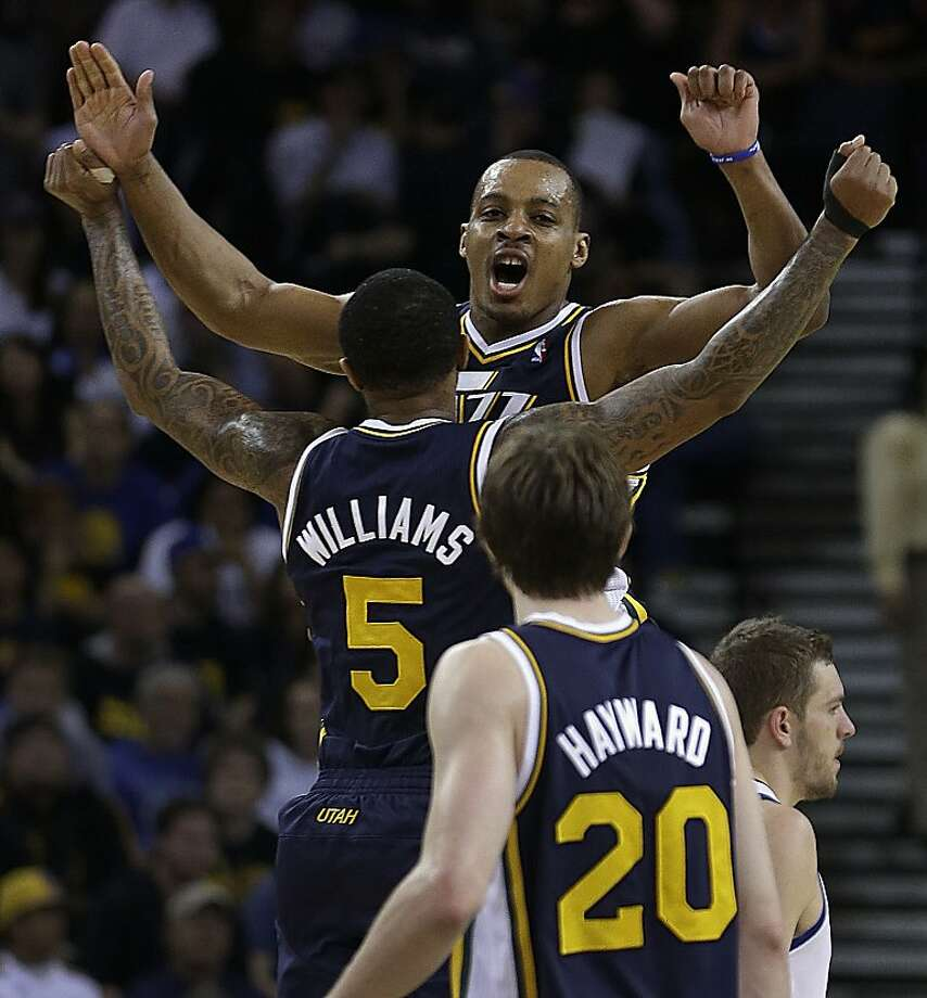 Utah Jazz' Mo Williams (5) and Randy Foye celebrate during the final seconds of an NBA basketball game against the Golden State Warriors Sunday, April 7, 2013, in Oakland, Calif. (AP Photo/Ben Margot) Photo: Ben Margot, Associated Press