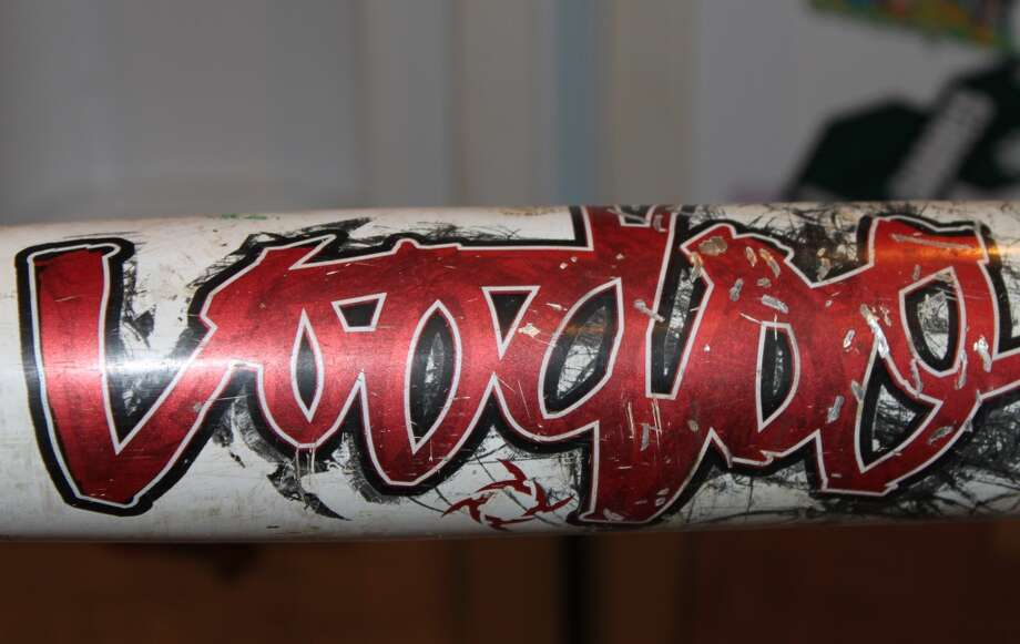 A close up of a Demarini Vodoo bat.