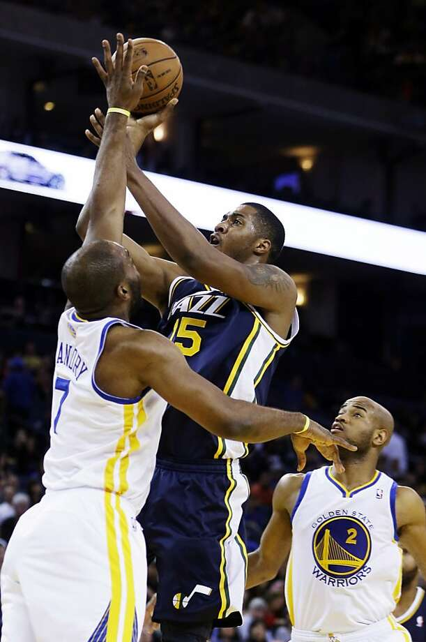 Utah Jazz's Derrick Favors (15) shoots over Golden State Warriors' Carl Landry during the first half of an NBA basketball game, Sunday, April 7, 2013, in Oakland, Calif. (AP Photo/Ben Margot) Photo: Ben Margot, Associated Press