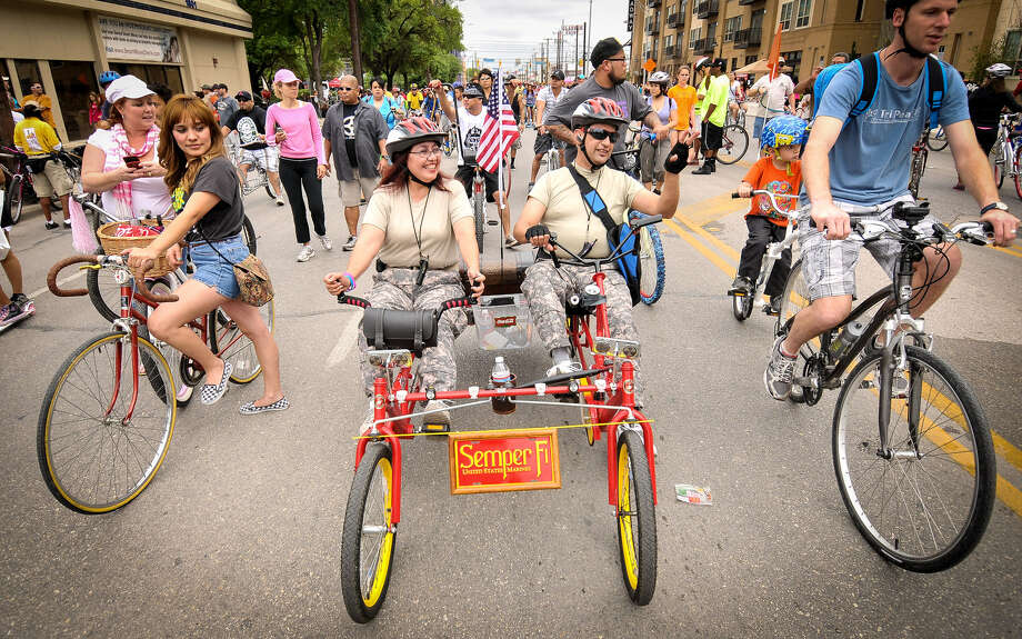 Annie and Jerry Moreno ride their quadcycle along Broadway, closed to motorized vehicles, during Sunday's fourth annual Síclovía, hosted by the YMCA and the city of San Antonio and sponsored by H-E-B. Photo: Photos By Robin Jerstad / For The San Antonio Express-News
